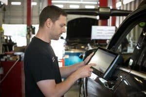 Service Tech working on car at Revolution Motor Works